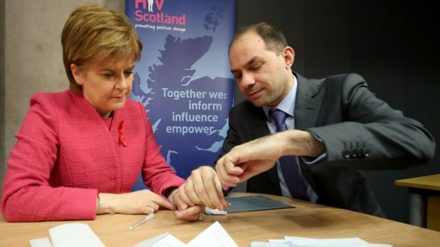 First Minister Nicola Sturgeon is given an HIV test by George Valiotis, chief executive of HIV Scotland, at the Scottish Parliament, Edinburgh